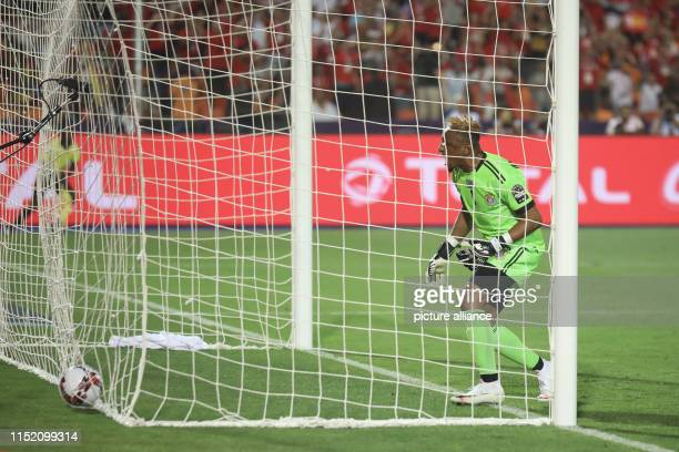 DR Congo goalkeeper Ley Matampi reacts in frustration after conceding Egypt's first goal during the 2019 Africa Cup of Nations Group A soccer match...