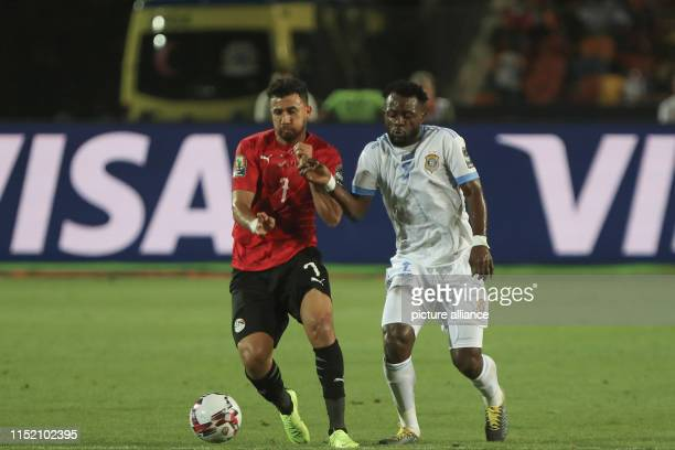 DR Congo's Djos Issama and Egypt's Mahmoud Hassan 'Trezeguet' battle for the ball during the 2019 Africa Cup of Nations Group A soccer match between...