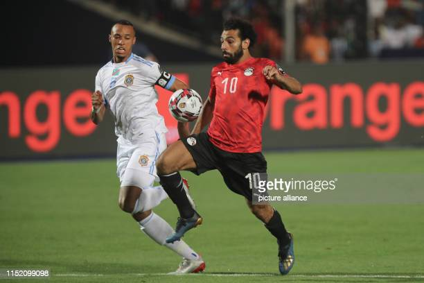 DR Congo's Marcel Tisserand and Egypt's Mohamed Salah during the 2019 Africa Cup of Nations Group A soccer match between Egypt and the Democratic...