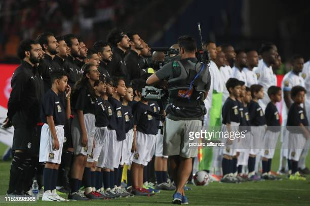 Egypt and DR Congo players observe the national anthems prior to the start of the 2019 Africa Cup of Nations Group A soccer match between Egypt and...