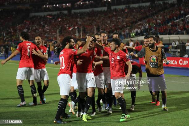 Egypt players celebrate scoring their first goal during the 2019 Africa Cup of Nations Group A soccer match between Egypt and Zimbabwe at the Cairo...