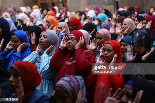 Egyptian Muslims attend Eid alFitr mass prayer to mark the end of the holy Muslims' holy fasting month of Ramadan at MosqueMadrassa of Sultan Hassan...