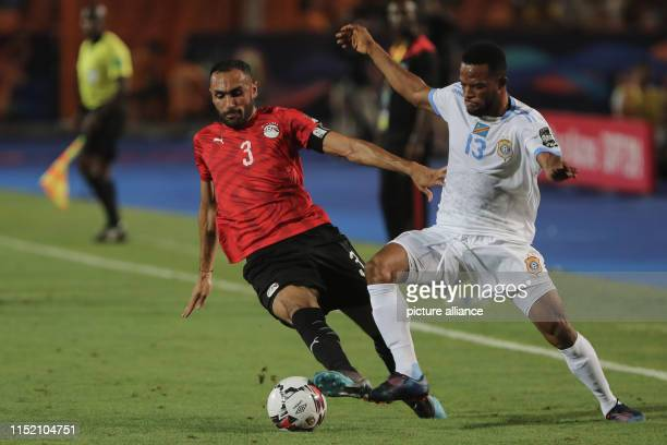 Egypt's Ahmed Elmohamady and DR Congo's Elia Meschak battle for the ball during the 2019 Africa Cup of Nations Group A soccer match between Egypt and...
