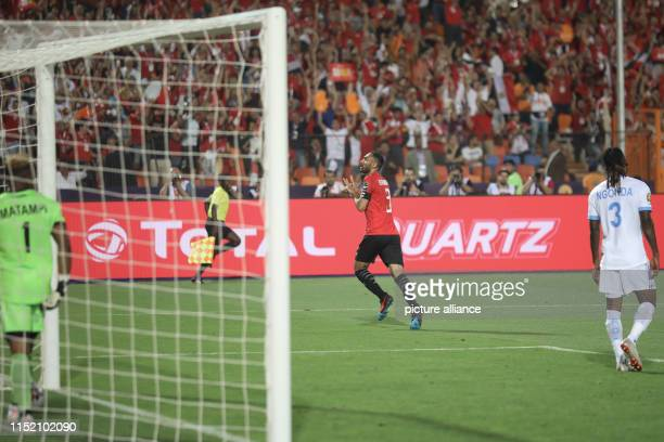 Egypt's Ahmed Elmohamady celebrates scoring his side's first goal during the 2019 Africa Cup of Nations Group A soccer match between Egypt and the...