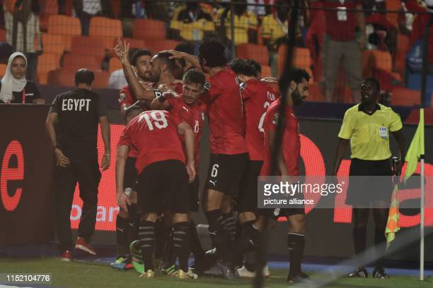 Egypt's Ahmed Elmohamady celebrates with his teammates after scoring his side's first goal during the 2019 Africa Cup of Nations Group A soccer match...