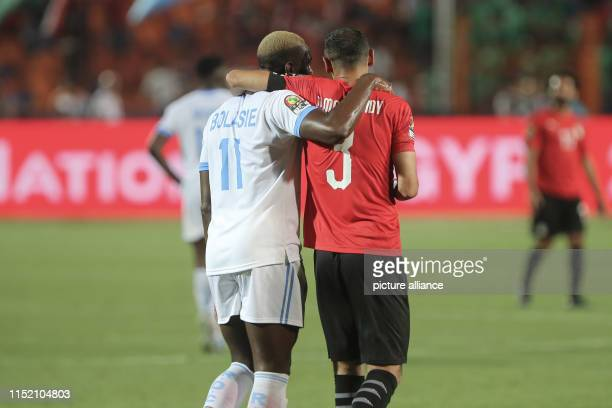 Egypt's Ahmed Elmohamady embraces DR Congo's Yannick Bolasie after the final whistle of the 2019 Africa Cup of Nations Group A soccer match between...