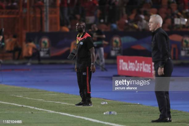 Egypt's head coach Javier Aguirre and DR Congo's head coach Florent Ibenge stand on the touchline during the 2019 Africa Cup of Nations Group A...