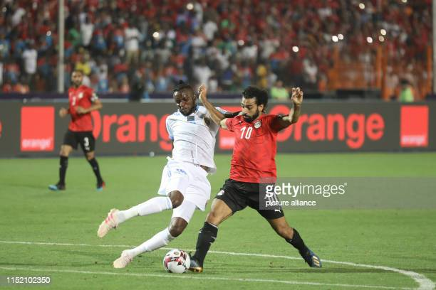 Egypt's Mohamed Salah and DR Congo's Merveille Bokadi battle for the ball during the 2019 Africa Cup of Nations Group A soccer match between Egypt...