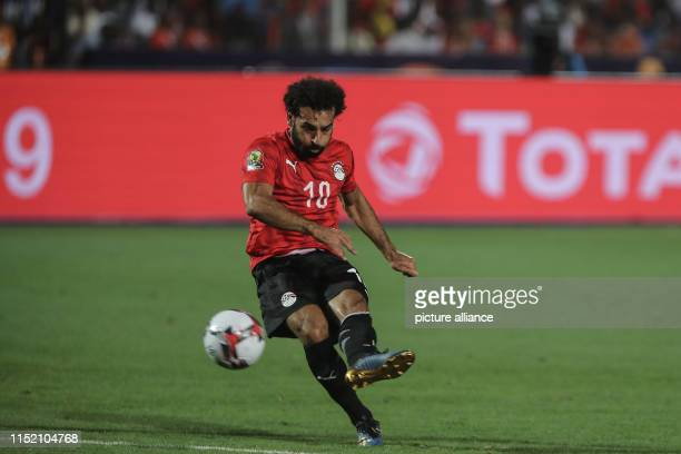 Egypt's Mohamed Salah takes on a free kick during the 2019 Africa Cup of Nations Group A soccer match between Egypt and the Democratic Republic of...
