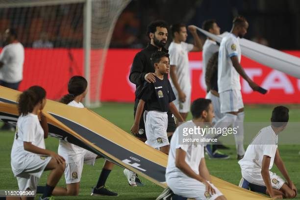 Egypt's Mohamed Salah walks onto the pitch prior to the start of the 2019 Africa Cup of Nations Group A soccer match between Egypt and the Democratic...