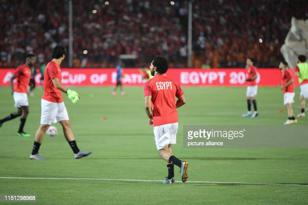 Egypt's Mohamed Salah warms up prior to the start of the 2019 Africa Cup of Nations Group A soccer match between Egypt and Zimbabwe at the Cairo...