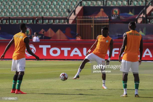 Ivory coast players warm up prior to the start of the 2019 Africa Cup of Nations Group D soccer match between South Africa and Ivory coast at AlSalam...