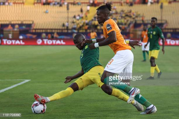 Ivory coast's Jonathan Kodjia and South Africa's Thamsanqa Mkhize battle for the ball during the 2019 Africa Cup of Nations Group D soccer match...