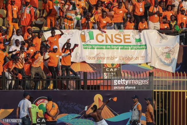 Ivory coast's Jonathan Kodjia celebrates with fans after the final whistle of the 2019 Africa Cup of Nations Group D soccer match between South...