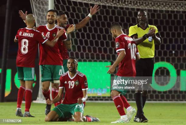 Morocco's players celebrate their victory after the 2019 Africa Cup of Nations Group D soccer match between Morocco and Ivory coast at AlSalam...
