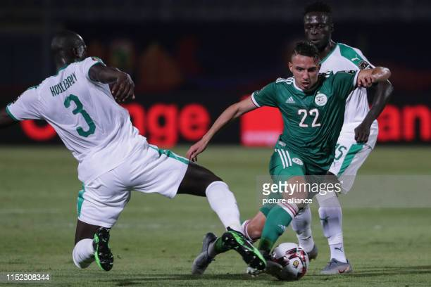Senegal's Kalidou Koulibaly and Algeria's Ismael Bennacer Belaili battle for the ball during the 2019 Africa Cup of Nations Group C soccer match...
