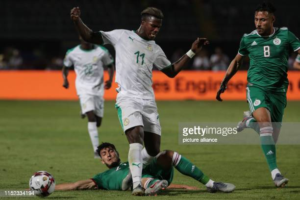 Senegal's Keita Balde Diao and Algeria's Ramy Bensebaini  battle for the ball during the 2019 Africa Cup of Nations Group C soccer match between...