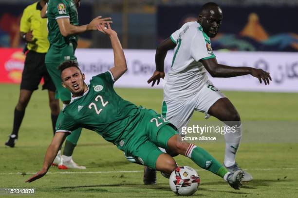 Senegal's Youssouf Sabaly and Algeria's Ismael Bennacer in action during the 2019 Africa Cup of Nations Group C soccer match between Senegal and...