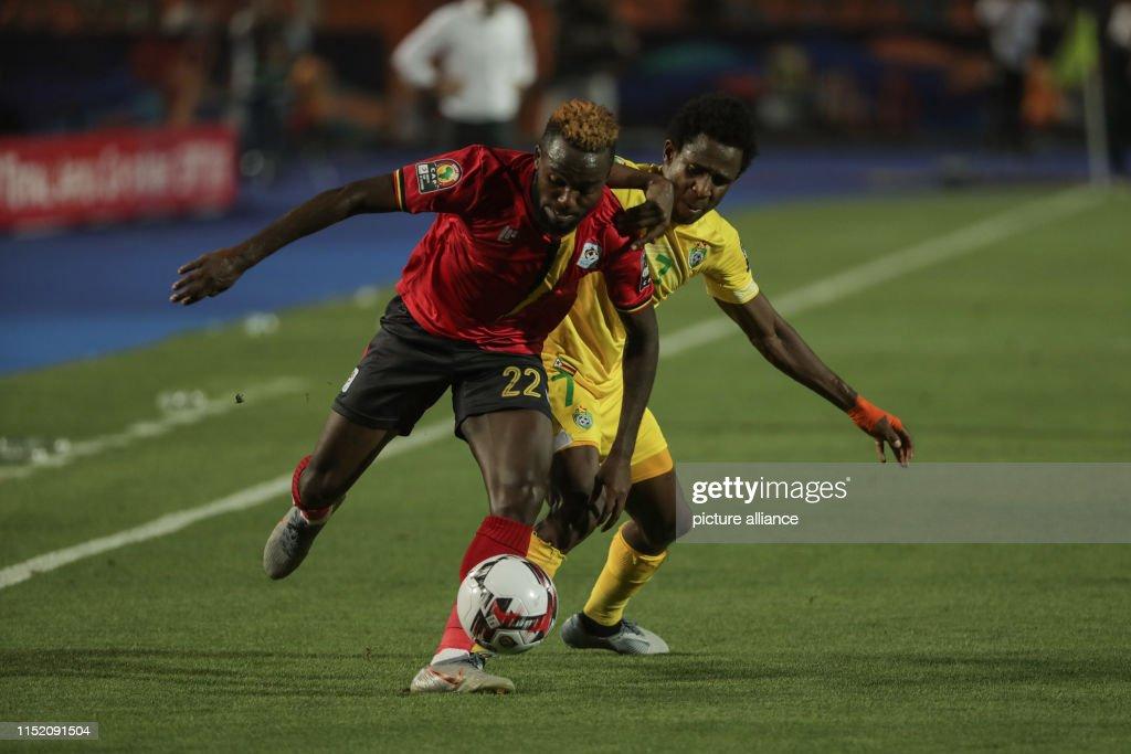 Uganda's Lumala Abdu and Zimbabwe's Talent Chawapiwa battle for the