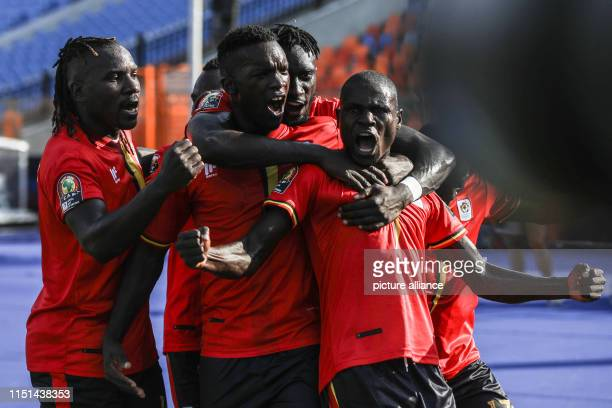 June 2019, Egypt, Cairo: Uganda's Patrick Kaddu celebrates with is teammates after scoring his side's first goal during the 2019 Africa Cup of...