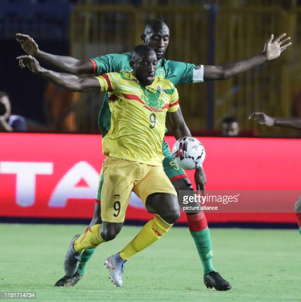 Mali's Moussa Marega and Mauritania's Abdoul Ba battle for the ball during the 2019 Africa Cup of Nations Group E soccer match between Mali and...