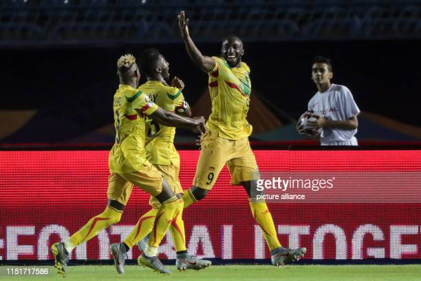 Mali's Moussa Marega celebrates scoring his side's second goal from a penalty kick during the 2019 Africa Cup of Nations Group E soccer match between...