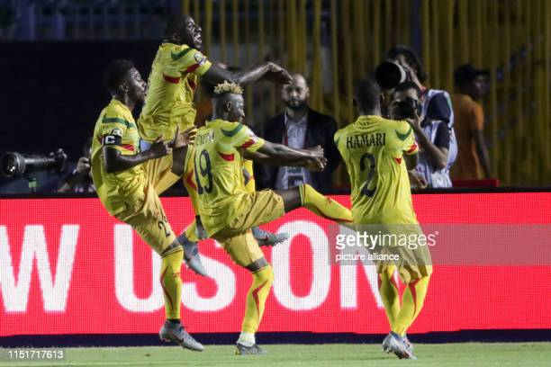 Mali's Moussa Marega celebrates with teammates after scoring his side's second goal from a penalty kick during the 2019 Africa Cup of Nations Group E...