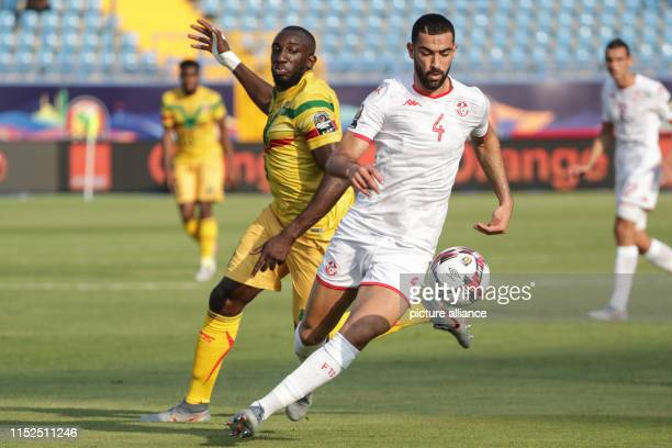 Tunisia's Yassine Meriah and Mali's Moussa Marega battle for the ball during the 2019 Africa Cup of Nations Group E soccer match between Tunisia and...