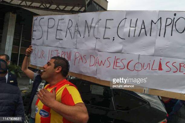 Fans of Esperance Sportive de Tunis shout slogans as the Confederation of African Football holds an emergency meeting of its executive committee to...