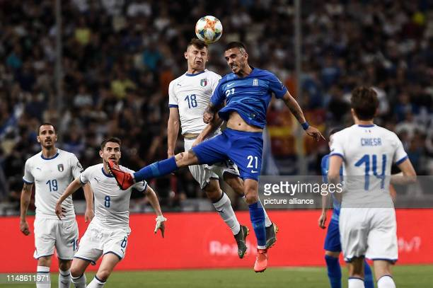 Soccer European Championship qualification Greece Italy group stage Group J 3rd matchday in OAKA stadium Nicolo Barella from Italy in a header duel...