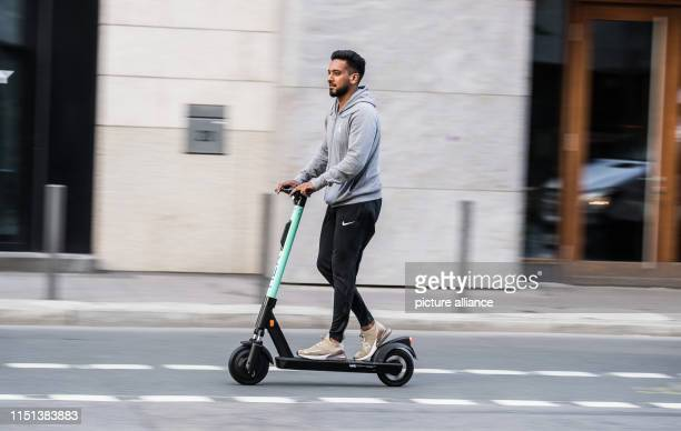 Haseeb Rafiq from the service provider Liefery drives an electric scooter to the installation site The company Tier Mobility starts the escooter...
