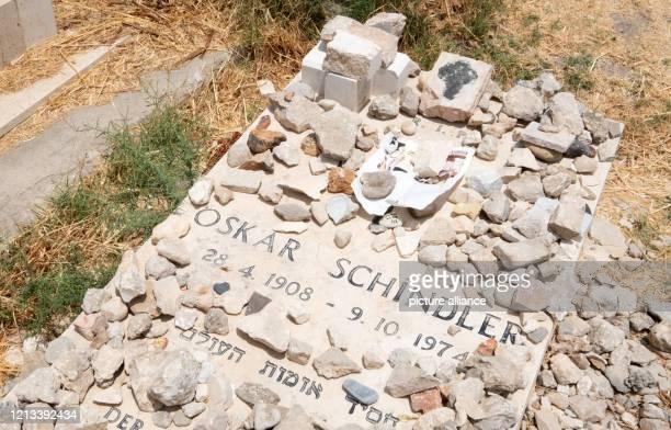 June 2019, Israel, Jerusalem: Homage stones on the grave of German businessman Oskar Schindler, in the Catholic cemetery in Jerusalem. The...
