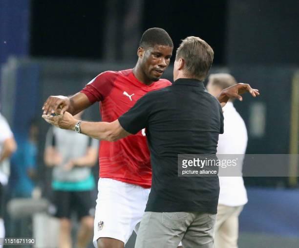Football U21 Men Germany Austria European Championship preliminary round Group B Kevin Danso from Austria celebrates his penalty goal with coach...