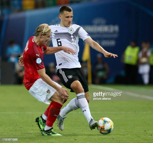 Football U21 men Germany Austria European Championship preliminary round Group B Maximilian Eggestein from Germany and Xaver Schlager from Austria in...