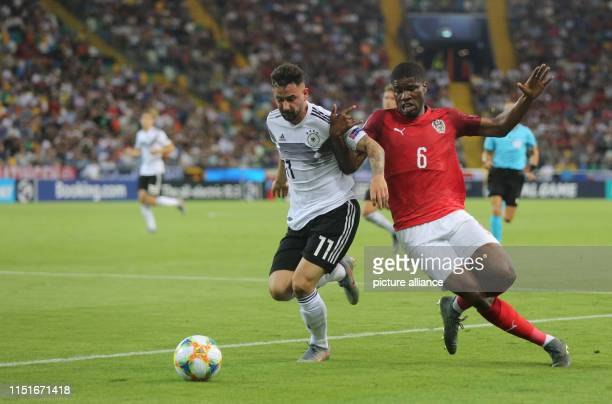 Football U21 men Germany Austria European Championship preliminary round Group B Marco Richter from Germany and Kevin Danso from Austria in action...