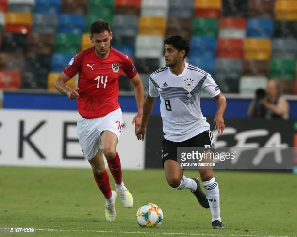 Football U21 men Germany Austria European Championship preliminary round Group B Mahmoud Dahoud from Germany and Husein Balic from Austria in action...