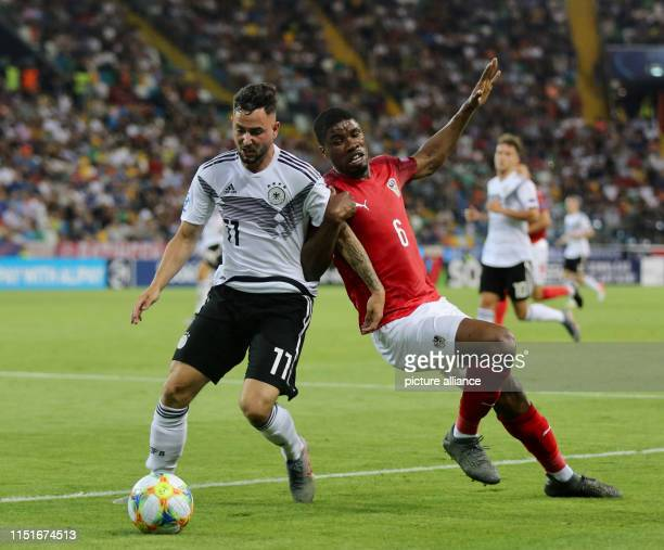 Football U21 men Germany Austria European Championship preliminary round Group B Marco Richter from Germany and Kevin Denso from Austria in action...