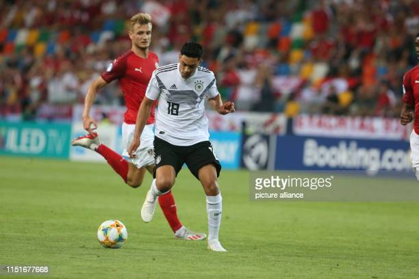 Football U21 men Germany Austria European Championship preliminary round Group B Nadiem Amiri from Germany and Stefan Posch from Austria in action...