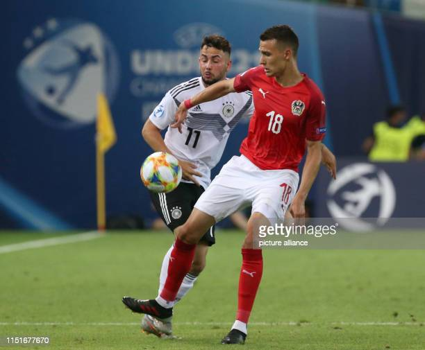 Football U21 men Germany Austria European Championship preliminary round Group B Marco Richter from Germany and Dejan Ljubicic from Austria in action...