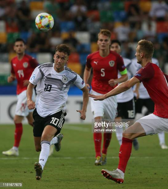 Football U21 men Germany Austria European Championship preliminary round Group B Luca Waldschmidt from Germany and Stefan Posch from Austria in...
