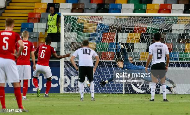 Soccer U21 men Germany Austria European Championship preliminary round Group B Kevin Danso scores a penalty against Alexander Nübel from Germany...