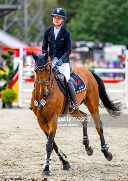 Julia Krajeski winner of the German Championships in eventing leaves the course with her horse Samourai du Thot after her victory in show jumping at...