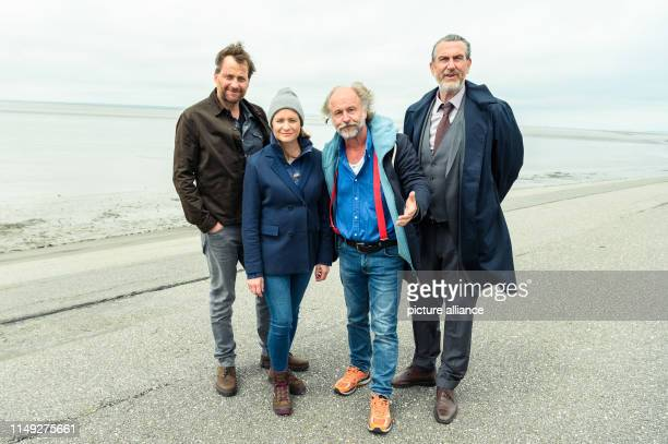 Christian Erdmann Julia Jentsch KlausPeter Wolf and Kai Maertens stand on the dike during the press date for the Saturday thriller Ostfriesengrab The...