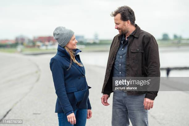 Julia Jentsch and Christian Erdmann are standing on the dike during the press date for the Saturday thriller Ostfriesengrab The fourth film in the...