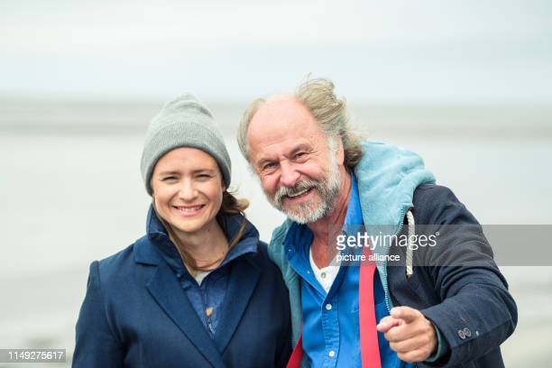Julia Jentsch and KlausPeter Wolf are standing on the dike during the press date for the Saturday crime thriller Ostfriesengrab The fourth film in...