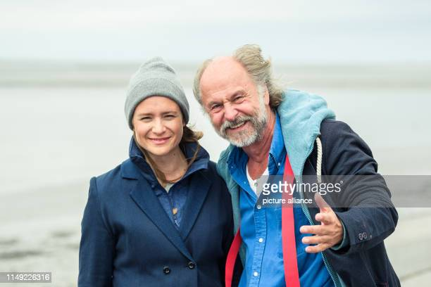 Julia Jentsch KlausPeter Wolf are standing on the dike during the press date for the Saturday thriller Ostfriesengrab The fourth film in the...