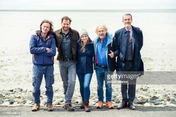 Martin Lehwald Christian Erdmann Julia Jentsch KlausPeter Wolf and Kai Maertens stand grouped for a photo at the dyke during the press date for the...