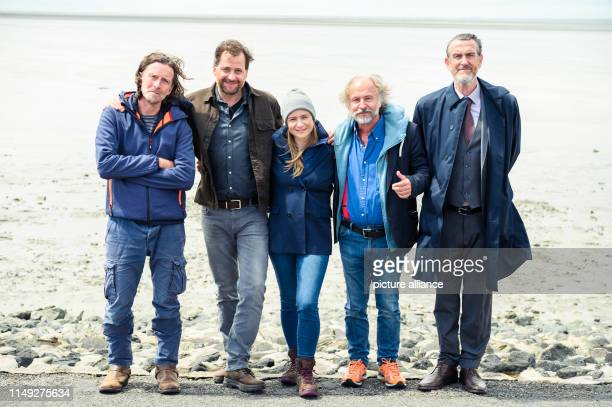 Martin Lehwald Christian Erdmann Julia Jentsch KlausPeter Wolf and Kai Maertens stand grouped for a photo at the dyke during the press conference for...