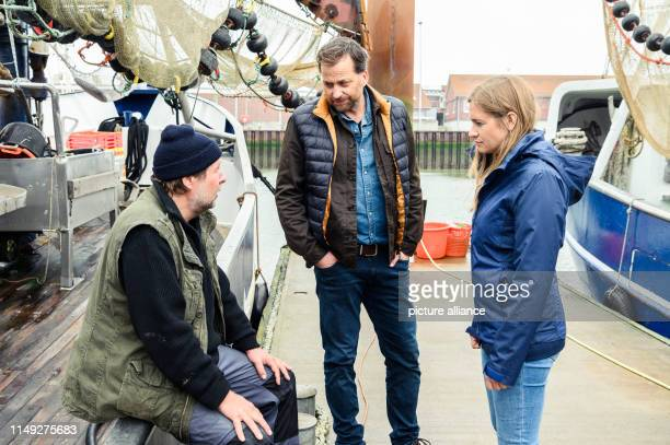 June 2019, Lower Saxony, Norddeich: Steffen Münster Christian Erdmann and Julia Jentsch are on set during the shooting of the Saturday thriller...