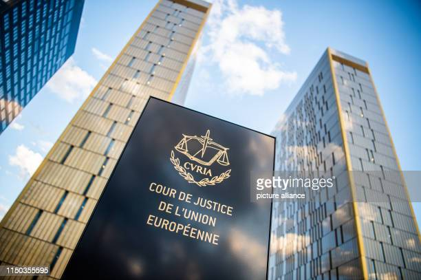 The picture shows a sign in front of the office towers of the European Court of Justice with the inscription Cour de Justice de l'union Européene in...